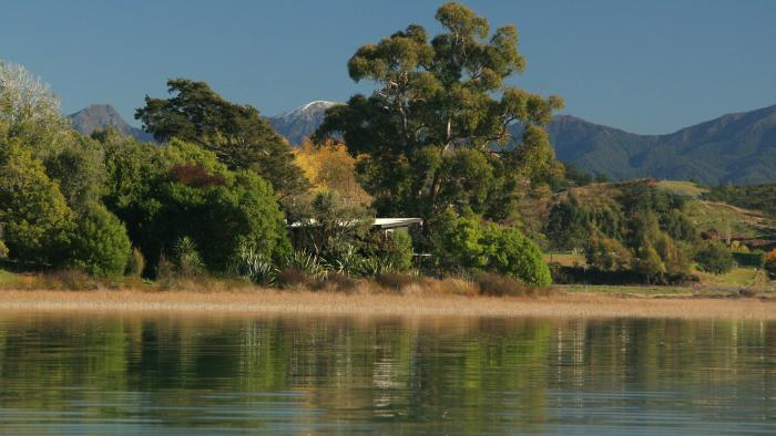 A Miro cottage from the estuary WL copy Matahua Cottages