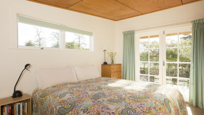C Karaka Master bedroom WL copy Matahua Cottages