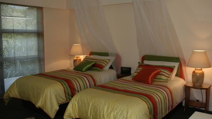 Internationally themed guest rooms 4 mosquito nets are just for decoration Twin Waters Lodge