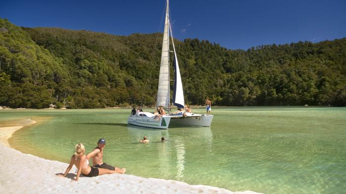 Relaxing on sea sand IAN6187 Abel Tasman Sailing Adventures