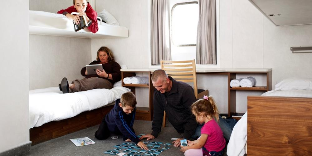 Family in four berth cabin low res Bluebridge Cook Strait Ferries
